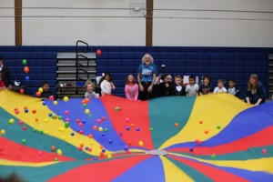 Little Shop of Science students playing with a giant parachute